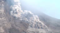 A large and dangerous pyroclastic flow sweeps down the side of Sinabung volcano during an eruption on 19th June 2015