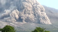 A large and dangerous pyroclastic flow sweeps down the side of Sinabung volcano in Sumatra Indonesia during a major eruption on 19th June 2015