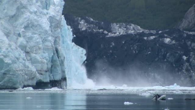 MS, Large chunk of ice calving, Margerie Glacier, Tarr Inlet, Glacier Bay National Park and Preserve, Alaska, USA