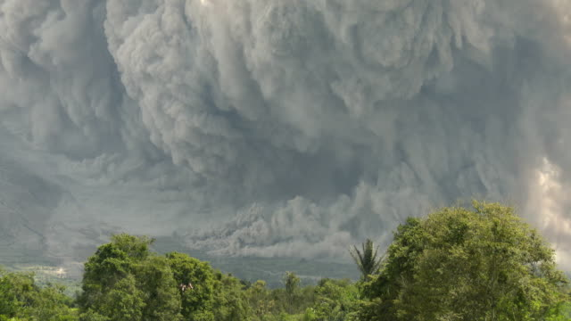 A large cloud of volcanic ash erupts from Sinabung volcano in Sumatra Indonesia during a major eruption on 19th June 2015