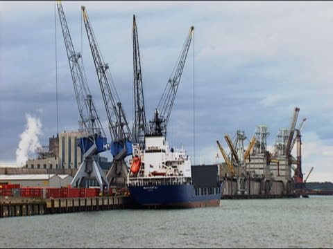 Large cranes at work in port of Rotterdam, South Holland, Netherlands