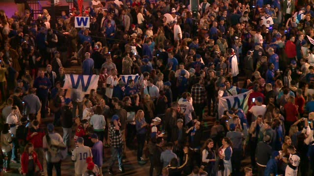 WGN Large Crowd Celebrates in Front of Wrigley Field After Cubs Win Wild Card Game in Chicago on October 7 2015