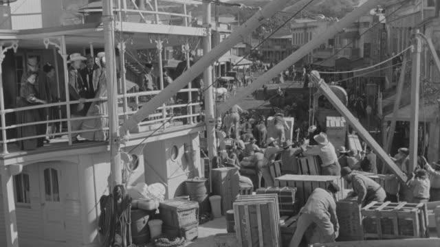 MS Large crowd loading boat on docks / Unspecified