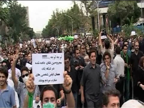 Large crowd of protesters walk along streets of Tehran chanting in support of Hossein Musavi following presidential elections results Iran 18 June...