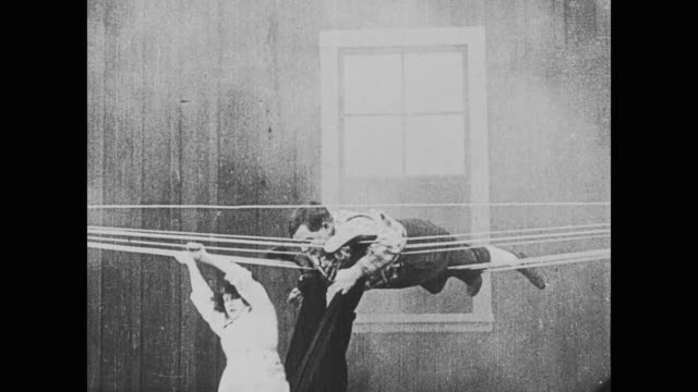 A large crowd tries to help the Daring and Athletic Molly escape from a fire, but they leave for lunch, leaving Fatty Arbuckle and Buster Keaton to help her