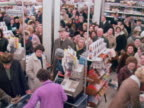Large crowds gather at the checkouts of a supermarket