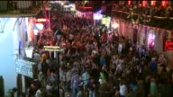 Large Crowds Of People Partying On Bourbon Street During Mardi Gras in New Orleans on Feb 13 2015