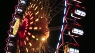 A large Ferris wheel turns illuminated in front of the Fernsehturm tower at a Christmas Market in Berlin on Wednesday December 10 the Ferris wheel...