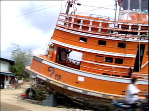 Large fishing boat washed up onto roadside by force of tsunami Baan Nam Khem Thailand 6 Jan 05