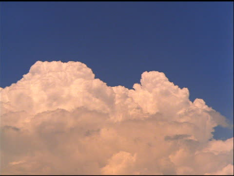 Large formation of billowing white clouds