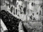 Large group of Jews make their way to the Wall of Lamentation / Jerusalem Israel