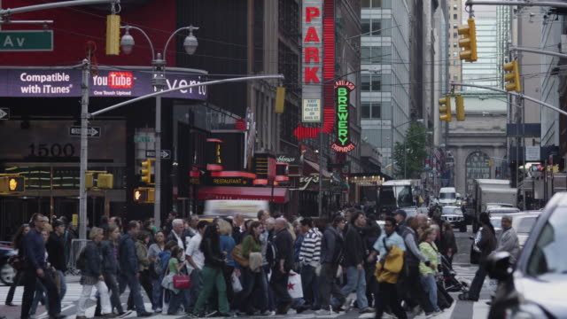 WS Large group of pedestrians crossing street / New York City, New York State, USA