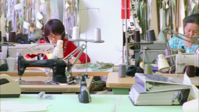 MS PAN Large group of people working in fashion designer's workshop / New York City, New York, USA