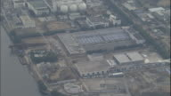 A large industrial plant in the Keihin industrial zone of Kanagawa, Japan is surrounded by  warehouses and gas tanks.