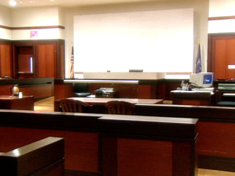 A large marble square decorates a portion of the wall behind the judge's bench in the Queens County Criminal Courts Building in Queens New York