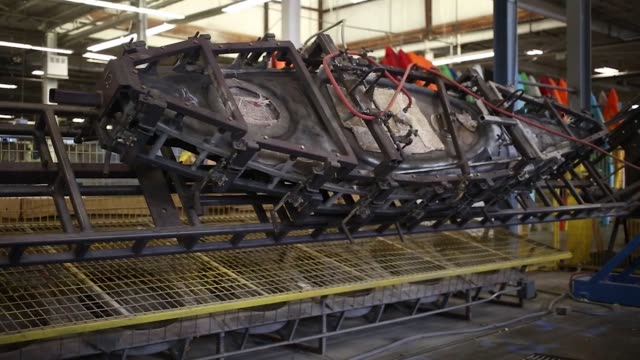 A large metal kayak mold is used in production at the Jackson Kayak Inc factory in Sparta Tennessee US on Wednesday Oct 4 Photographer Luke Sharrett...