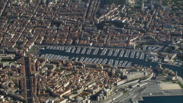 AERIAL Large number of boats in marina/ ZO traffic on coast/ Marseilles, France