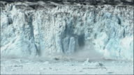Large pieces of the Columbia Glacier break off and splash into the ocean. Available in HD.