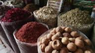 CU R/F Large plastic bags of spices at outdoor spice market / Dubai, United Arab Emirates