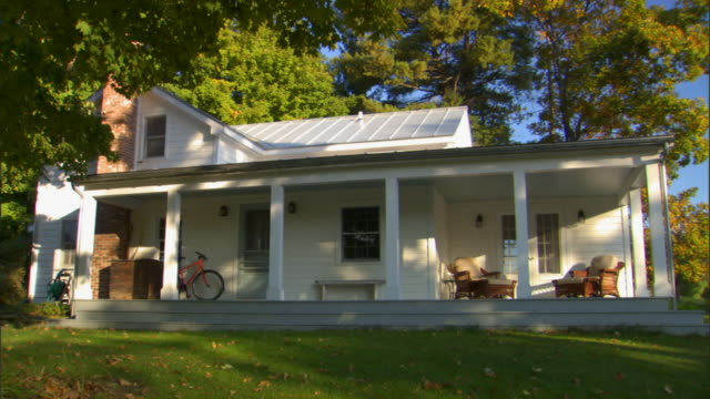 WS Large porch of house surrounded by trees/ Livingston, New York