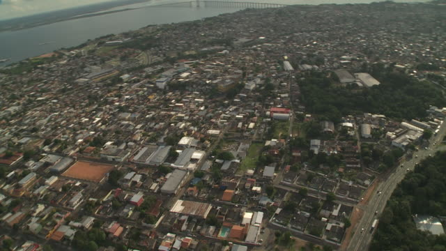 A large rainforest grows in the middle of Manaus, Brazil.
