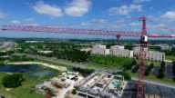 Large Red Construction Crane Heavy Machinery Aerial Drone Side Pan moving across the Arm