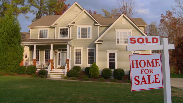 WS, PAN, Large suburban house with 'Sold' sign in front yard, Richmond, Virginia, USA