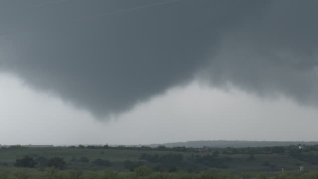 Large Tornado Touching Down Over The Rural Countryside