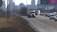 Large Trucks Driving Down Highway in Chicago on Jan 19 2015