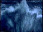 Large wave crashes up over camera