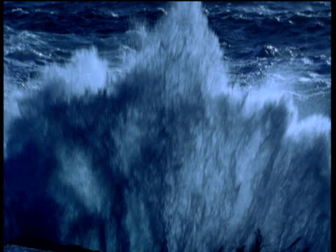 Large wave crashes up over camera