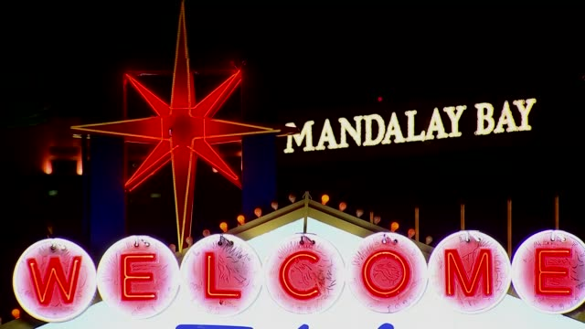 Investigation into gunman Stephen Paddock continues USA Nevada Las Vegas Close shot of neon 'Welcome' sign with 'Mandalay Bay' neon sign on hotel in...