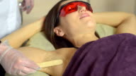 laser epilation  for a young woman in the spa