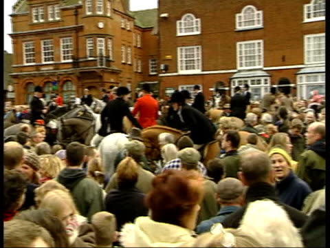 Last Boxing Day meets before possible ban ITN Buckinghamshire Members of hunt riding thru square of market town to applause Antihunt protestors...