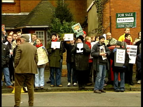 Last Boxing Day meets before possible ban ITN Members of hunt riding thru square of market town to applause Antihunt protesters gathered Ditto PAN...