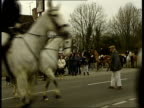 Last Legal Day of Hunting ENGLAND Leicestershire EXT MS Huntsmaster blowing horn PAN as hunt sets off GV Hunt riders along East Sussex Catsfield...