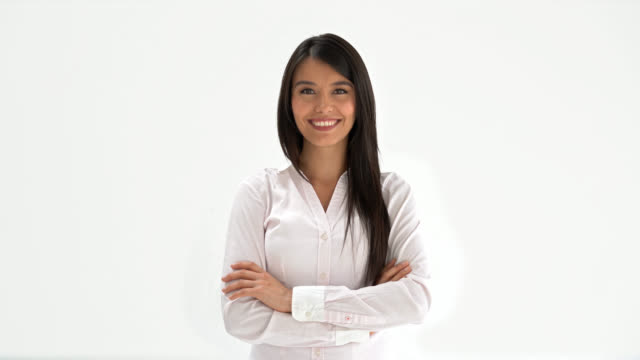 Latin american woman looking at the camera with arms crossed