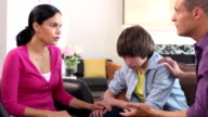 Latin Parents have Serious Discussion with Son - Wide Shot