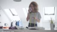 Latina Tailor In Her Workshop