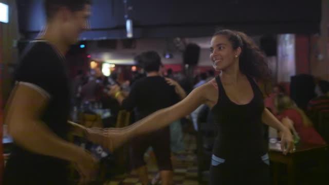 A Latino couple dance in a salsa club / Medellin, Colombia