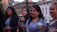 MS Laughing female family members on restaurant deck before dinner