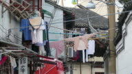 Laundry Hanging Outside across Narrow Alley, Shanghai, China