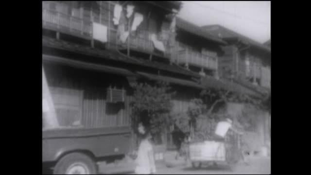 Laundry hangs from a row of houses near Tsukudajima, Japan.