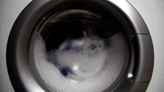 Laundry inside a washing machine drum