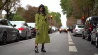Laura Comolli wears a green trench coat outside Valentino during Paris Fashion Week Womenswear Spring/Summer 2018 on October 1 2017 in Paris France