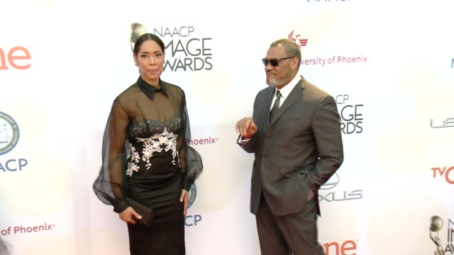 Laurence Fishburne and Gina Torres at the 46th Annual NAACP Image Awards Arrivals at Pasadena Civic Auditorium on February 06 2015 in Pasadena...