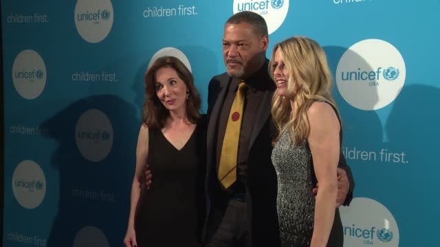 Laurence Fishburne Sara Shlesinger and Ally Wandtke at UNICEF's Evening For Children First In Atlanta on March 17 2017 in Atlanta Georgia