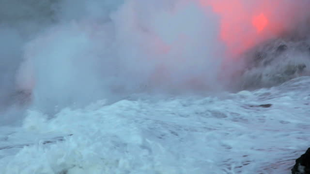 MS Lava flowing into sea and forming steam cloud at dawn / Kalapana, Hawaii, USA