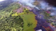 Lava from the Kilauea Volcano flows across the ground on November 7 2014 in Pahoa Hawaii Molten rock from the flow is inching its way towards homes...