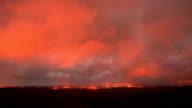 Lava milky way dark sky storm timelapse Night Glowing Hot flow from Kilauea Active Volcano Puu Oo Vent Active Volcano Magma